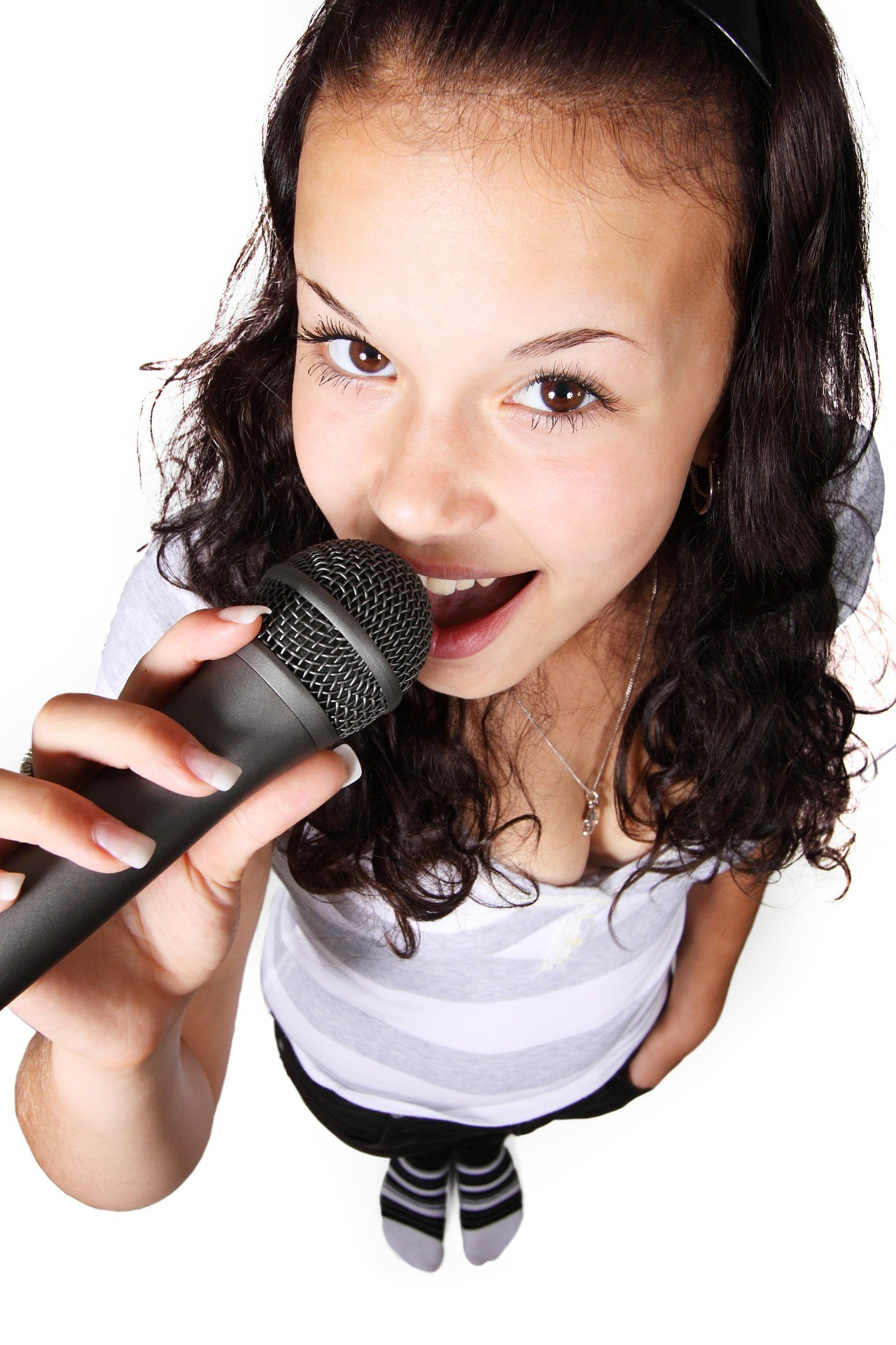 Photograph of a girl singing a song